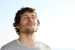 attractive-man-breathing-outdoor-sky-background-35879609